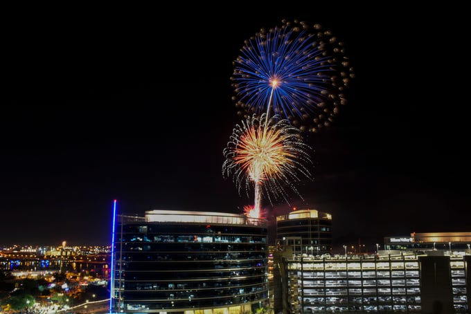 Fireworks blast above the skyline viewed from the Hayden Butte on July 4, 2019, in Tempe. Families and friends gathered at the Tempe Town Lake Festival to celebrate July 4th.