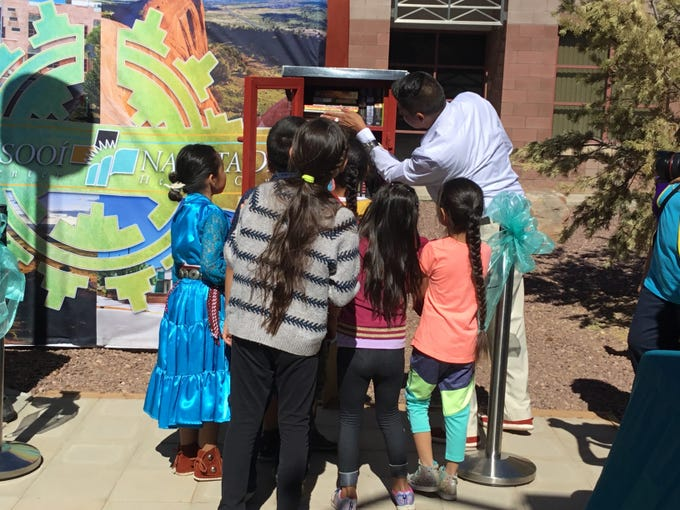 Duane Yazzie with eager young readers at the grand opening of Little Free Library at the Tséhootsooí Medical Center in Fort Defiance on June 21, 2019.