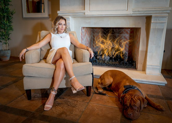 "Scottsdale realtor Kimberly Tocco and her dog, Blue. Tocco will star in the first episode of the HGTV series ""Pool Hunters."""
