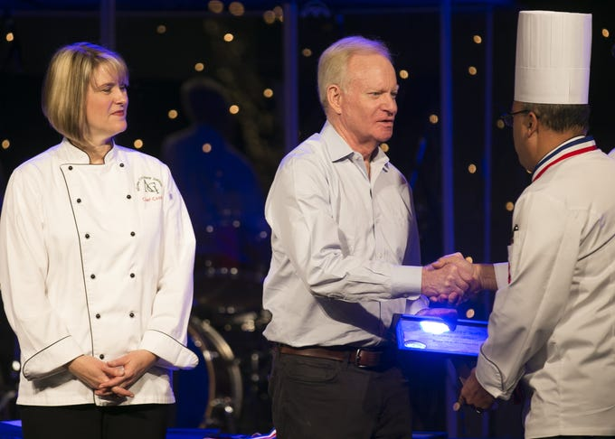 Former Arizona Governor and co-founder of the Arizona Culinary Institute Fife Symington shakes hands with graduates of the institute at McDowell Mountain Community Church in Scottsdale on Dec. 7, 2018.