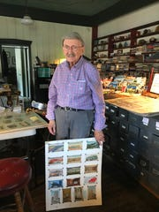 Donald Brown standing with one of his postcard boards at the Institute of American Deltiology in Myerstown.