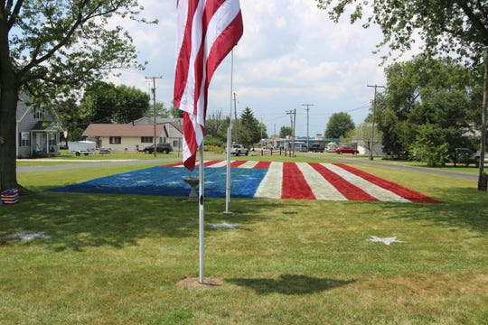 It took Majewski about 12-hours to finish the flag using a biodegradable chalk-based paint that will not harm the environment. Due to the cost of the paint as well as the very high temperatures, Majewski said he decided to paint the Betsy Ross flag with 13 stars.