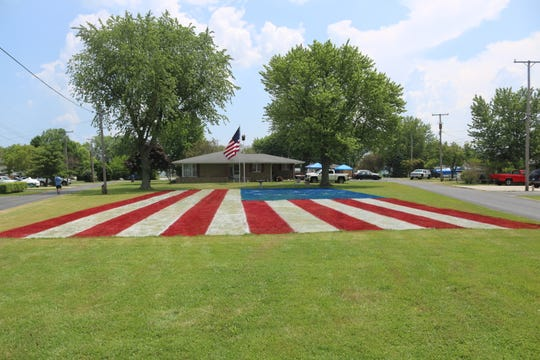 In addition to painting a giant flag on his lawn, J.R. Majewski of Port Clinton is planning a big fireworks display on Saturday.