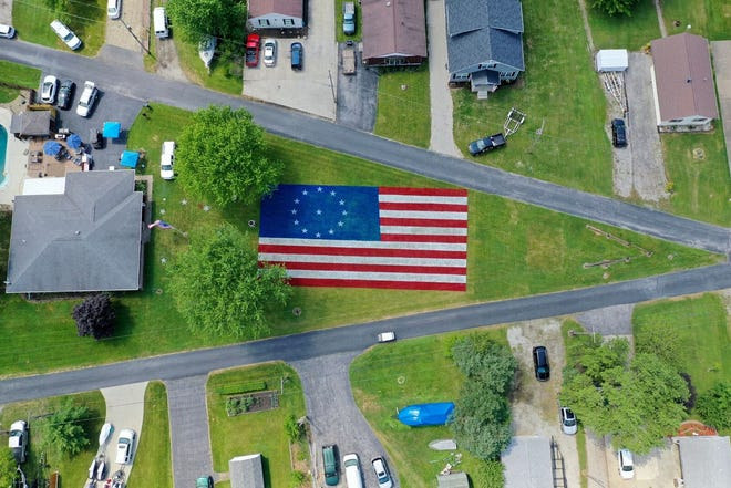 It took J.R. Majewski about 12 hours to finish this giant American flag painted in his front yard.