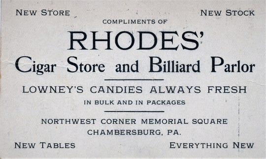 An advertisement card for the Rhodes' Billiard Parlor in the early 1900s.
