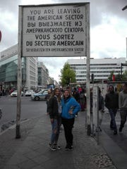 Morgan Schafer and Laura, a host student, at Checkpoint Charlie in Berlin.