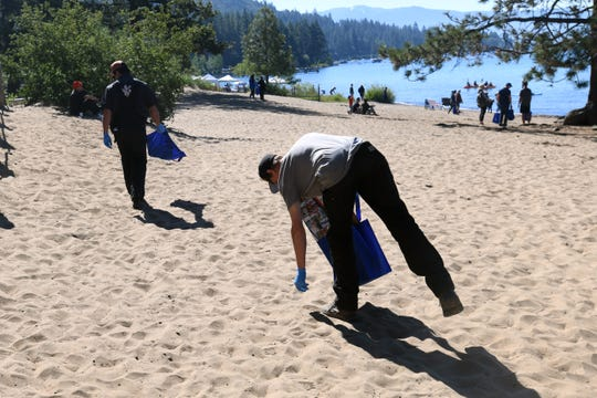 Nicholas McKnight, 27, from the North Lake Tahoe area, participates in the 2019 Keep Tahoe Red, White and Blue Beach Cleanup in Kings Beach, California.