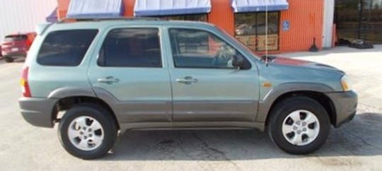 Suelan Tao was seen driving a green Mazda Tribute SUV similar to this one.