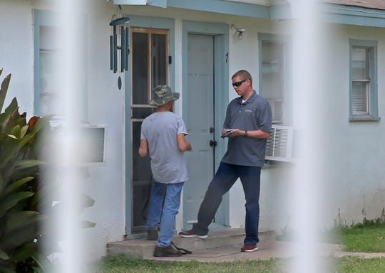 Sgt. John Bouligny, right, interviews an individual on Friday regarding an incident caught on tape at the Pops Concert in San Angelo on Wednesday, June 3, that showed a man hitting a dog.