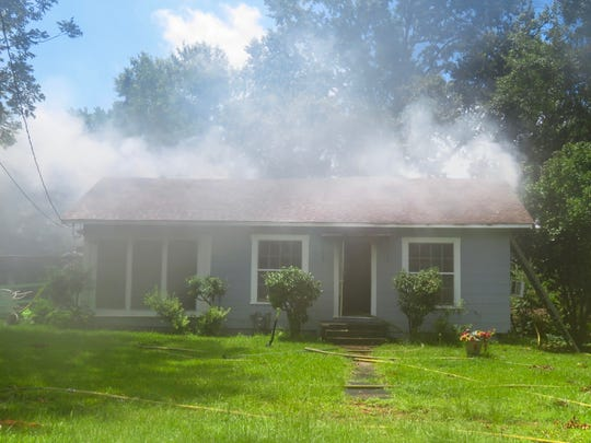 Smoke is seen coming from a house in the 4500 block of Lyba Street in Shreveport on Friday, July 5, 2019.