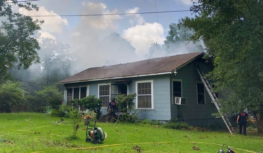 Smoke is seen exiting a house in the 4500 block of Lyba Street on Friday, July 5, 2019.
