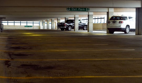 Parking spaces remain empty throughout the 1st Avenue garage on Friday, July 5, in Sioux Falls.