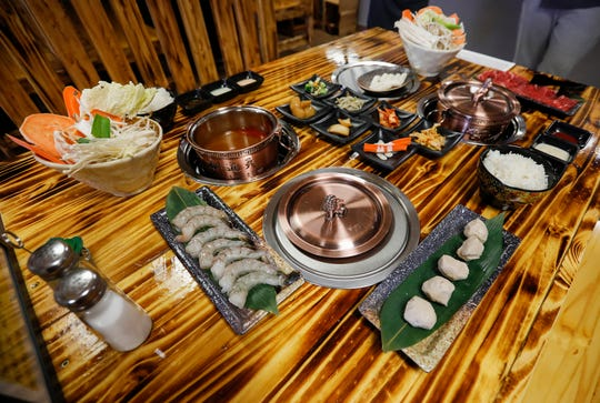 Each order of hot pot at Little Korea comes with broth, a vegetable basket, choice of protein, rice, sauces, and side dishes called banchan. The new restaurant is located at 3354 S. National Ave. in Springfield, Missouri.