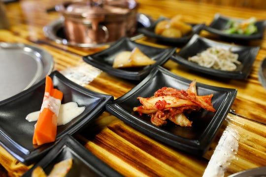 The side dishes at Little Korea, called banchan, include items like kimchi, carrot and broccoli.
