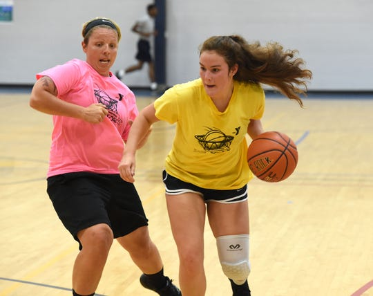 Emma Witt, right, is one of several high school players in the YMCA's all-women's league. Witt is a rising sophomore at Staunton High School.