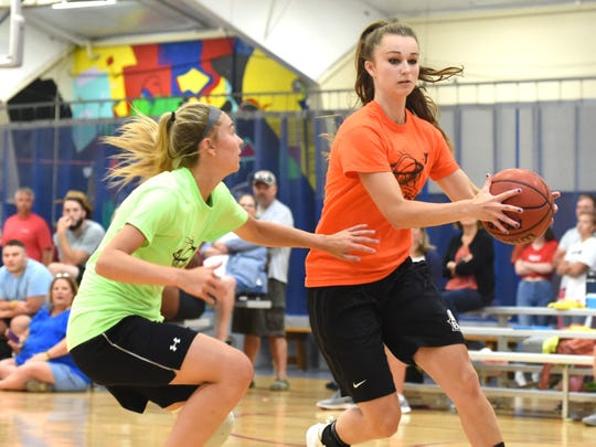Wilson Memorial junior Korinne Baska guards Eastern Mennonite University's Lexi Deffenbaugh Tuesday night during the YMCA's women's basketball league. Baska and her Wilson teammates are playing in the league this season.