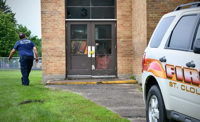 A door to St. Elizabeth Ann Seton Catholic School shows damage Friday, July 5, 2019, in St. Cloud. A fire was reported in the building just before 6 a.m. Thursday.