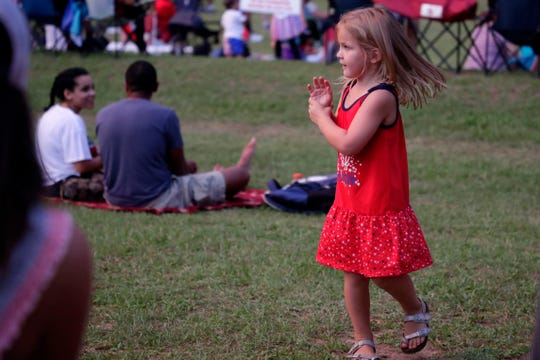 A young girl plays at Tom Brown Park, which on Saturday will feature an Oasis Fun Fest with games, bounce houses and food.