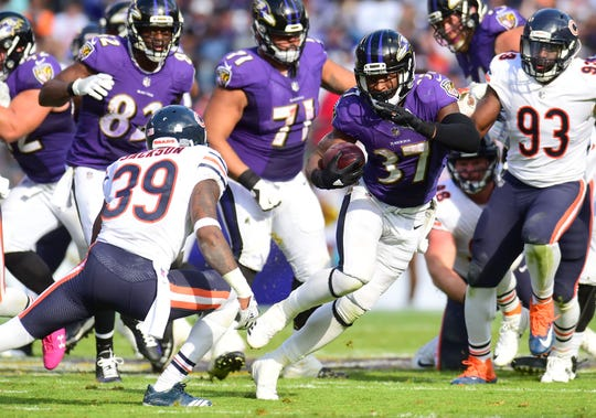 Baltimore Ravens running back Javorius Allen (37) runs with the ball in the fourth quarter against the Chicago Bears at M&T Bank Stadium on Oct. 15, 2017.