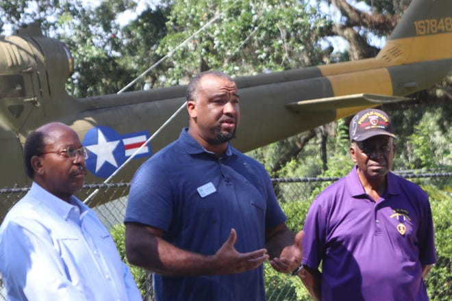 "The executive director of Big Bend Habitat for Humanity, Antoine Wright, along with City Commissioner Curtis Richardson (left) and Colonel Washington J. Sanchez (right) announce the launching of the Big Bend's Habitat for Humanity ""Veterans Build"" in a news conference at Lake Ella Friday."