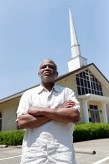 Patrick Mason, Director of the African-American studies program and professor of economics at Florida State University, poses for a photo in St. John Missionary Baptist Church in Bond Neighborhood Wednesday, July 3, 2019.