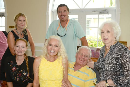 Jessi Lund, seated, left, Kip and Dr. Ron Lyman and Nancy Langhagen, with Mary Ann Koenig and Jeremy Lund, standing, at the Jewelia Project Art & Trunk Show at the Pelican Yacht Club in Fort Pierce.
