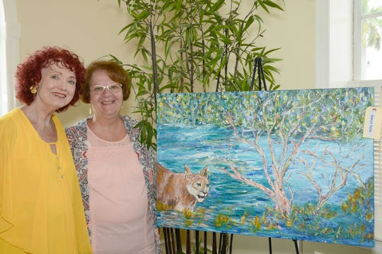 Artist Debra Terrio and Darlene Berube at the Jewelia Project Art & Trunk Show at the Pelican Yacht Club in Fort Pierce.