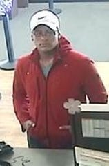 Police are looking for this man, who they say stole a large amount of cash from someone else's bank account using a bank card stolen out of a car.