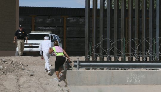 A group of asylum seekers crosses the border between El Paso and Juárez, Mexico, on July 4, 2019. Two other people behind them also turned themselves in to waiting Border Patrol agents.