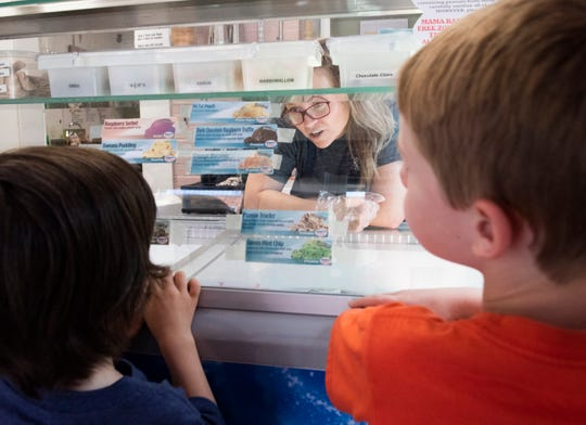Zachary Garrett, 5, right, and Daniel McFarland, 4, order ice cream at Mama Rae's Scoops on the Square in Pendleton.