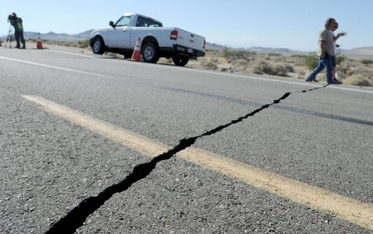 At least six cracks opened on the surface of Highway 178 northeast of Ridgecrest during Thursday's 6.4-magnitude earthquake. The epicenter was 11 miles northeast of Ridgecrest on a direct route along the highway.