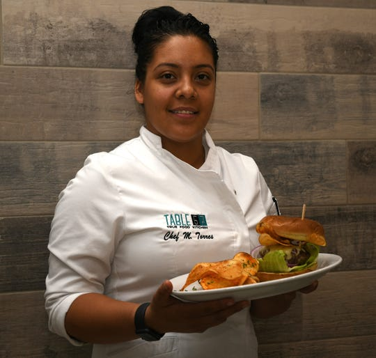 "Table 57 Executive Chef Monica Torres is a holdover from The Cafe. She said the menu keeps many cafe favorites with a ""fresh spin."""