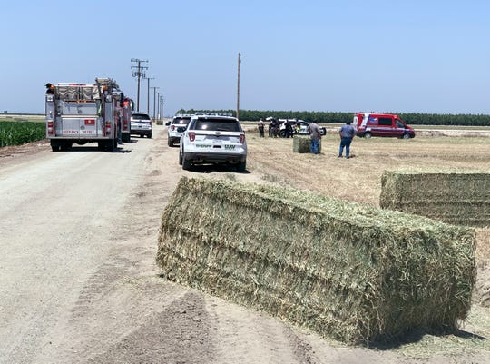 Tulare County Sheriff deputies investigate a collision between a tractor and a pedestrian in a field north of Avenue 384 and west of Road 76 on Friday, July 5, 2019.
