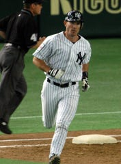 New York Yankees' John Flaherty rounds bases after hitting a two-run homer off Hanshin Tigers starter Katsuhiko Maekawa in the fourth inning of their exhibition game at Tokyo Dome Monday, March 29, 2004. The Yankees will meet the Tampa Bay Devil Rays in their two season-opening games of the major league in Japan at the indoor stadium from Tuesday.