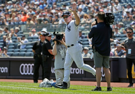 Former New York Yankee John Flaherty is introduced during Old Timer's Day at Yankee Stadium, Sunday, June 23, 2019, in New York. (AP Photo/Seth Wenig)