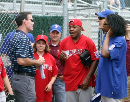 John Flaherty, a Pearl River resident and former player for the New York Yankees, greets players during a ceremony marking the 20th season of the Challenger Little League at the West Nyack Little League facility at Germonds Park June 10, 2012.