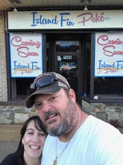 Owners Renee and John Tamboles pose in front of their future restaurant on Delaware Avenue in Wilmington.