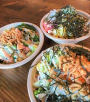 At Island Fin Poke, you can start with your choice of sushi rice, brown rice or mixed greens, then add a protein and toppings to create your own poke bowl.