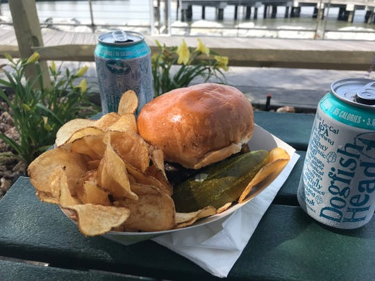 Burgers cooked on a wood-fired grill are $13.50 at the new Dogfish Head food truck at the Cape May-Lewes Ferry Terminal building. You can also order canned DFH beers.
