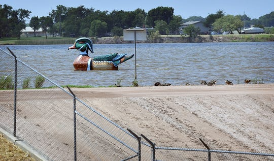 Wally the Wood Duck, a creation of Wichita Falls artist Ralph Stearns, floats quietly near the spillway of Lake Wichita Friday morning.
