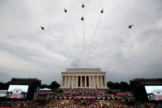 President Donald Trump, first lady Melania Trump, Vice President Mike Pence and Karen Pence and others stand as the US Army Band performs and the US Navy Blue Angels flyover at the end of an Independence Day celebration in front of the Lincoln Memorial, Thursday, July 4, 2019, in Washington.