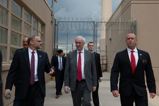 Deputy Attorney General Jeffrey Rosen (center) tours the Englewood Federal Correctional Institution with Hugh Hurwitz (at left), acting director of the Federal Bureau of Prisons. At right is the warden of the facility, Brad Greilick.
