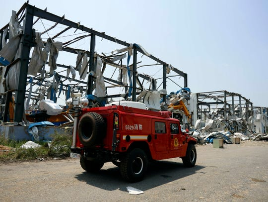 A fire truck past by a destroyed factory in the aftermath of a tornado in Kaiyuan in northeastern China's Liaoning province Thursday, July 4, 2019.