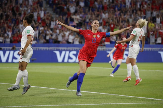 United States forward Alex Morgan (13) celebrates after scoring a goal against England in a semifinal match in the FIFA Women's World Cup France 2019 at Stade de Lyon.