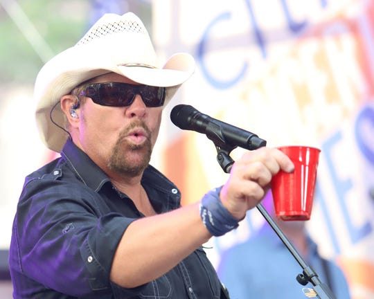 Toby Keith holds a red Solo cup as he performs on NBC's Today show at Rockefeller Plaza on July 5, 2019, in New York.