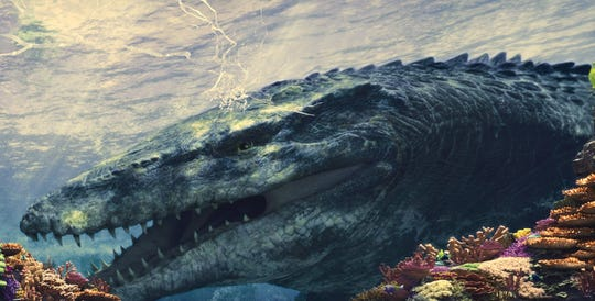 The Mosasaurus knocks against the aquarium screen at Universal Studios Hollywood.