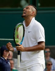 Australia's Nick Kyrgios reacts after winning a point against Spain's Rafael Nadal in a Men's singles match during day four of the Wimbledon Tennis Championships in London, Thursday, July 4, 2019.