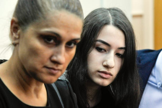In this photo taken on Wednesday, July 26, 2019, Krestina Khachaturyan, right, and her mother Aurelia Dunduk attend hearings in a court room in Moscow, Russia.