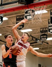 Kaukauna's Logan Jedwabny, left, drives to the basket against Reed Miller of Kimberly during a game last season.