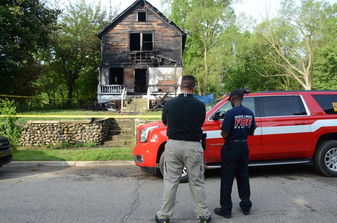 Battle Creek Police Detective Ryan Strunk, left, and Fire Marshal Quincy Jones were at the scene of a suspicious Saturday fire on Janoah Avenue.